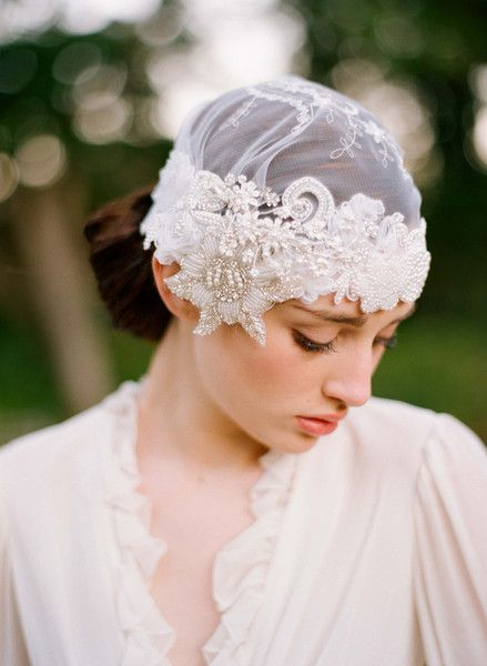 Featuring pearls and rhinestone accents, this romantic beaded lace bridal cap from Twigs & Honey is handmade to order.