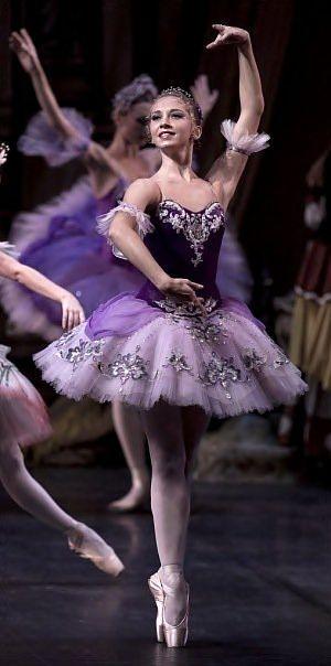 A ballerina in purple.