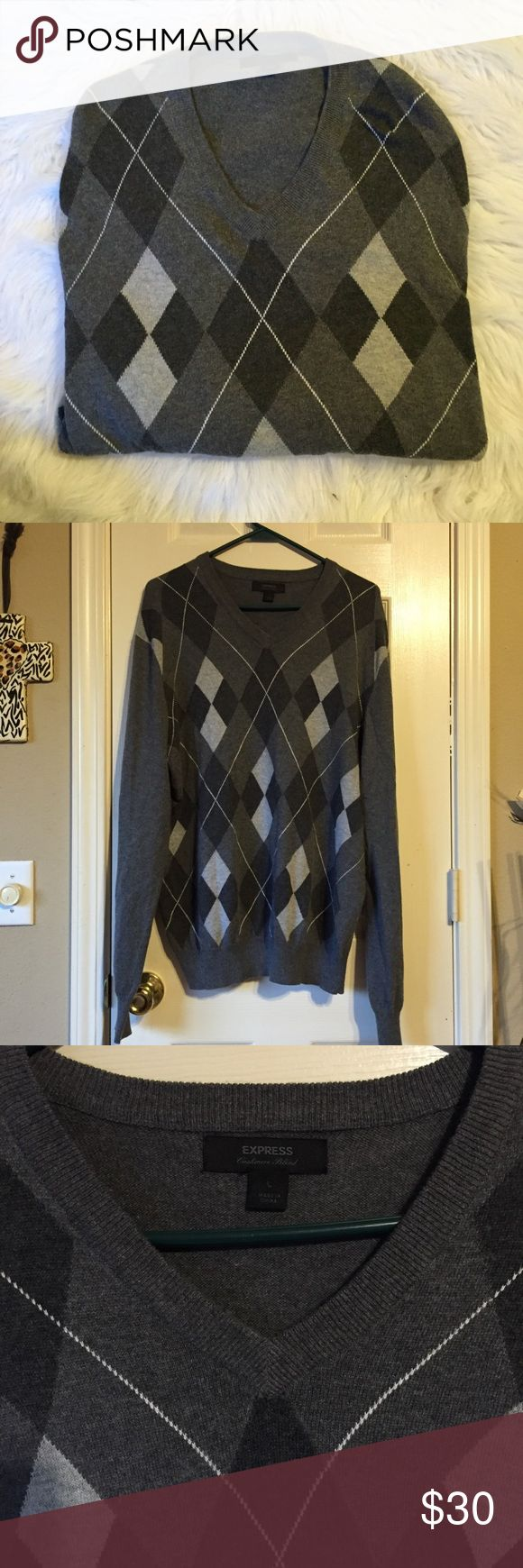 Express cashmere blend argyle sweater Express argyle sweater with different shades of gray and white. 85% cotton 15% cashmere. V-neck, long sleeves with ribbed elastic cuffs and straight hem with ribbed elastic. Express Sweaters V-Neck