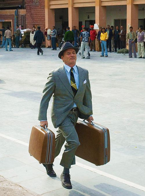 Bill Murray is awesome.   Tie clip. Pocket square. HAT. SUITCASES!