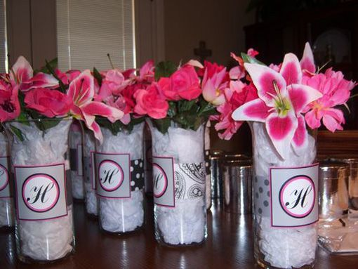 Another centerpiece idea--with red and white flowers instead; black or black-and-white ribbon and K monogram