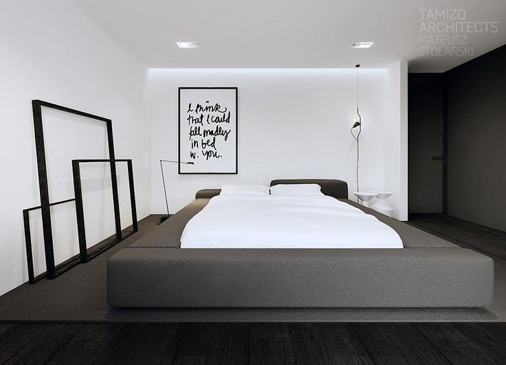In the bedroom, we're drawn to the empty frames leaning against the wall, which are a less than subtle way to emphasize the importance of negative space in this design.