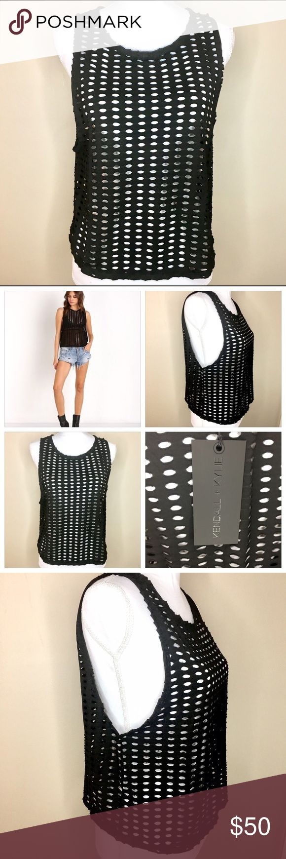 """KENDALL & KYLIE Black Laser Cut Tank Size Medium. NWT. Black Kendall & Kylie laser cut tank top. Size Medium. Polyester. Shoulder to hem measures approx 21"""". Armpit to armpit measures 19"""". Fabric does have some stretch. Kendall & Kylie Tops Tank Tops"""