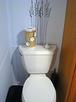 Oatmeal container recycled into toilet paper roll holder. So great because I have an oatmeal container saved and was trying to think of how to use it!