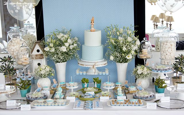 The elegant dessert table for this Peter Rabbit themed baptism party