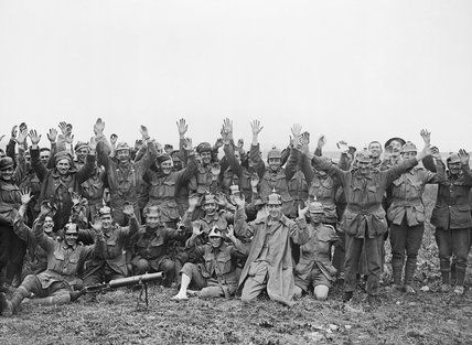 Men of the 1st Anzac Division, some wearing German Helmets, pose for the camera after fighting near Pozieres on 23 July 1916 during the Batt...