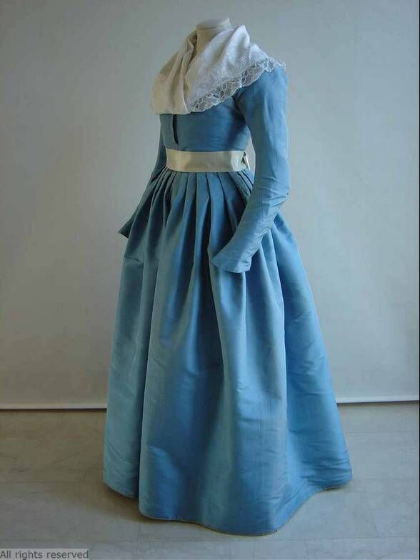 Levite or round gown, The Netherlands, 1780-1800. Sky blue silk taffeta with a light blue silk sash.
