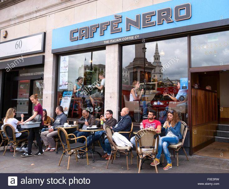 People sitting outside the Caffe Nero coffee shop, Trafalgar Square, London UK Stock Photo
