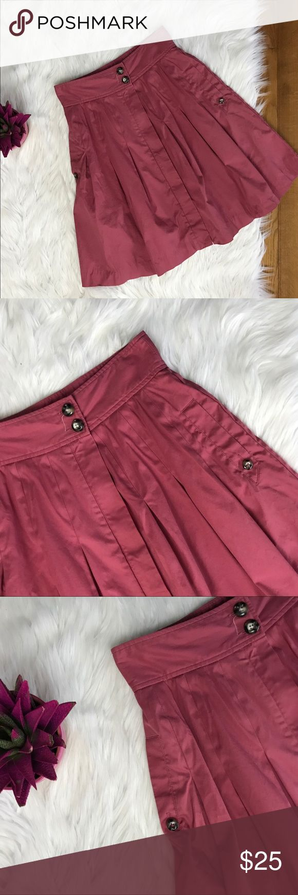 """Anthro's Fei Pleated A-Line Pink Skirt Fei Anthropologie Pleated A-Line Pink Cotton Blend Women's Skirt Pockets Size 8  Overall condition is good; some access threading & a very small/light marking on the front of the skirt (4th pictured)  *Front of the skirt buttons on the top and zips from the front. Zipper is covered by flap.  98% Cotton 2% Spandex  Dry Clean  Approximately: 21.5"""" Long 28"""" Circumference of waist  *Smoke free/pet free home Anthropologie Skirts A-Line or Full"""