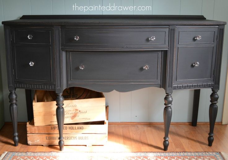 Sideboard beautifully refinished from mahogany to deep matte black with General Finishes Lamp Black milk paint and glass knobs from Home Depot. Gorgeous. from www.thepainteddrawer.com