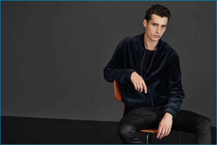 Adrien Sahores makes a style statement in a cotton velvet bomber jacket, satin pants, and a t-shirt from H&M.
