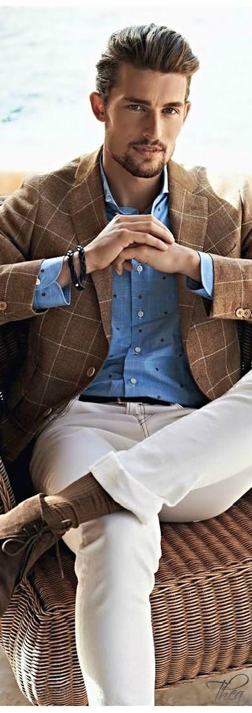 Shop this look on Lookastic:  http://lookastic.com/men/looks/blazer-long-sleeve-shirt-jeans-desert-boots-belt-bracelet-socks/11181  — Brown Suede Desert Boots  — Brown Socks  — Beige Jeans  — Black Leather Belt  — Blue Polka Dot Long Sleeve Shirt  — Brown Check Wool Blazer  — Black Bracelet