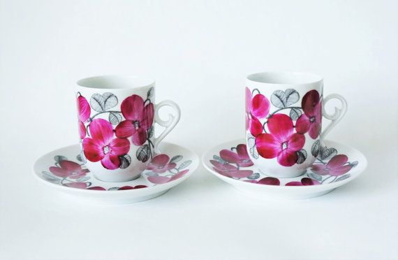 The listing is for 2 small coffee cups / espresso cups and saucer from Arabia of Finland. The floral decor is design by Esteri Tomula, the cup model is by Anja Jaatinen-Winquist. The Irina serie was in production in 1971-1972. The cups are handpainted, hence there are some color difference.  The cups and saucer are in good condition. There is a minor dot in the glazing, see pic 4.   The cups measure approx 6.5 cm / 2.3 in height and 5.2 cm / 2 in diameter. I think the cups can...