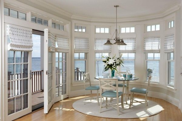 I want a room like this.  Everyone should have a room like this.  So clean, fresh, white, a touch of blue to match the ocean outside your expansive windows.