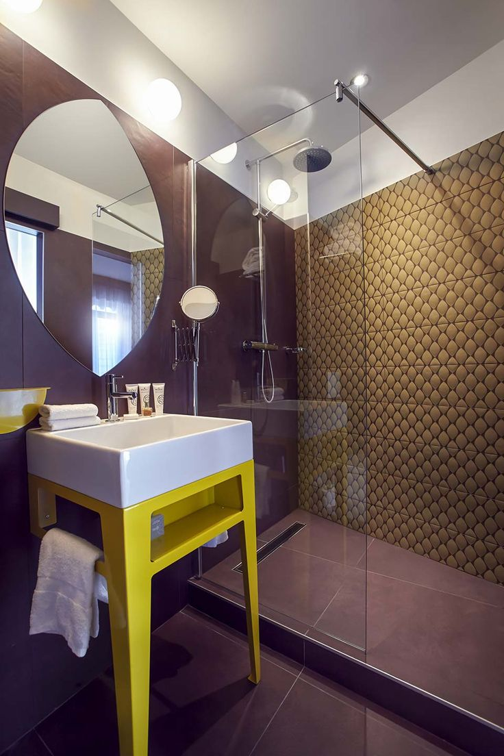 Grand Hôtel du Midi - hotel bathroom featuring Materia Project by Casamood   #wall #decoration #decor #bathroom #shower #glass #style #pattern #innovative #creative #purple #colors #mood #floor #tile #ceramics #porcelain #luxury #trend #french #project #Florim