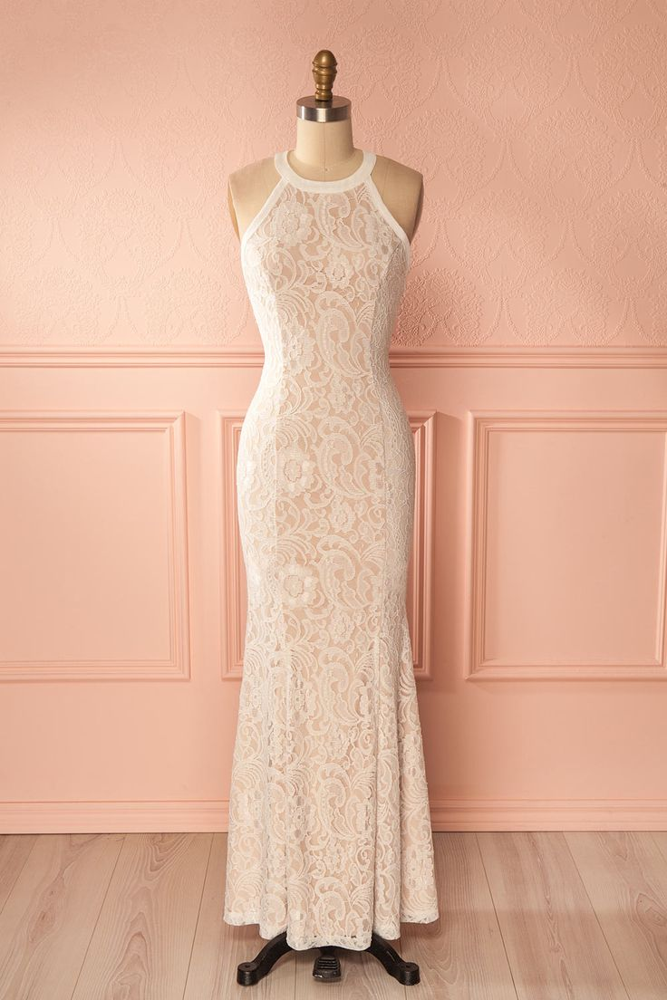 Fernanda Beige and White Lace Mermaid Gown | Boutique 1861 This flattering mermaid gown will give you a distinguished look and the open-back will bring out a playful and sensual side. The flared bottom has two short central slits so you can move with ease, while the slightly stretchable fabric and the halter neckline ensure an optimal fit. #promdresses #bride
