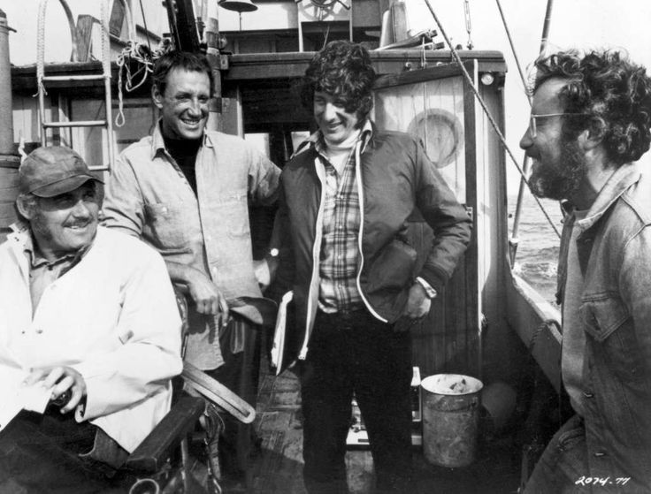 1975, British actor Robert Shaw, American actor Roy Scheider, American director Steven Spielberg, and American actor Richard Dreyfuss laugh together on a boat during the filming of Spielberg's 'Jaws'. (Photo by Universal Studios/Getty Images) Photo: Getty Images