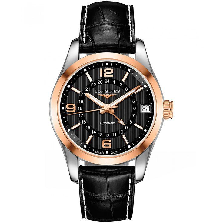 Reloj Longines de caja en oro y acero; bisel de oro extensible tipo correa en piel color negra carátula a contraste con manecillas luminiscentes movimiento calibre 704.2 y detalle de la marca.