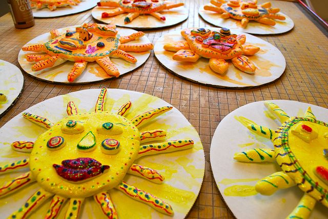 Suns made from Model magic, painted with watercolors , added designs with sharpies then added glitter paint on top