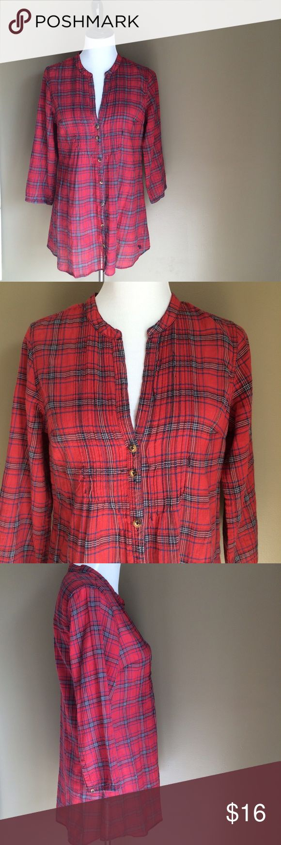 "Abercrombie & Fitch red plaid tunic For sale is a fun Fall red plaid tunic.  Pair this with leggings and boots and you are ready to go!  Nice and lightweight.  Buttons down entire front and on wrists.  Made of 99% cotton 1% elastane.  Measures 19.5"" armpit to armpit and 30"" length.  Great Preowned condition other than slight fraying on front.  Open to offers!  Thanks for looking! Abercrombie & Fitch Tops Tunics"