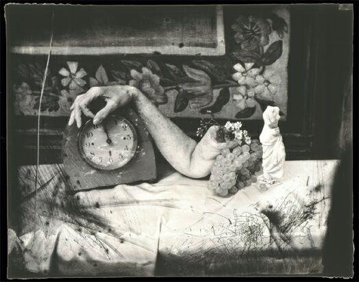 arm and clock still life