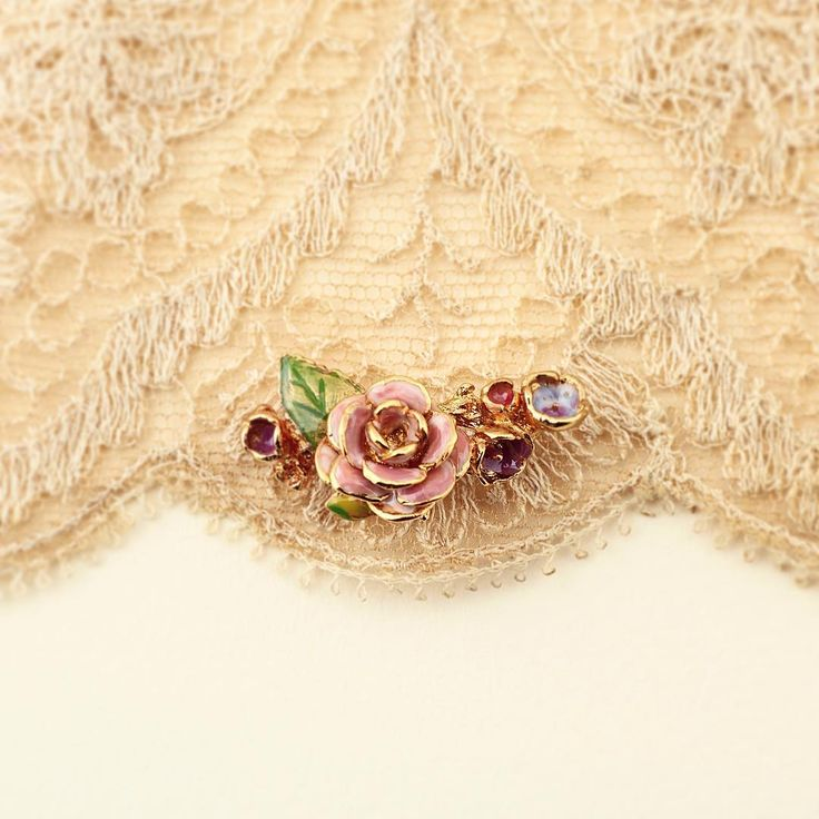:: The Vintage Rose Climber ::  . . . #BillSkinner #Vintage #vintagestyle #lace #vintagelace #chantillylace #stilllifephotography #fashion #design #earclimber #enamel #enameljewellery #enameljewelry #handpainted #rose #rosejewellery