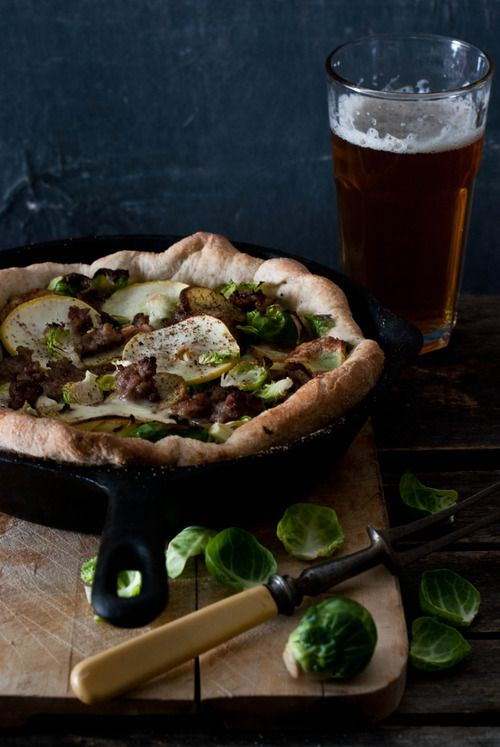 Brussels sprout, sausage, apple and roasted potato skillet pizza
