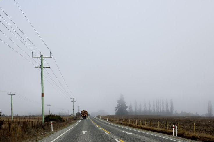 A photographic print by Elizabeth Bull for One Fine Print. #road #roadtrip #grey  #green #blue # misty #trees #landscape #print #art #newzealand #horizontal #truck