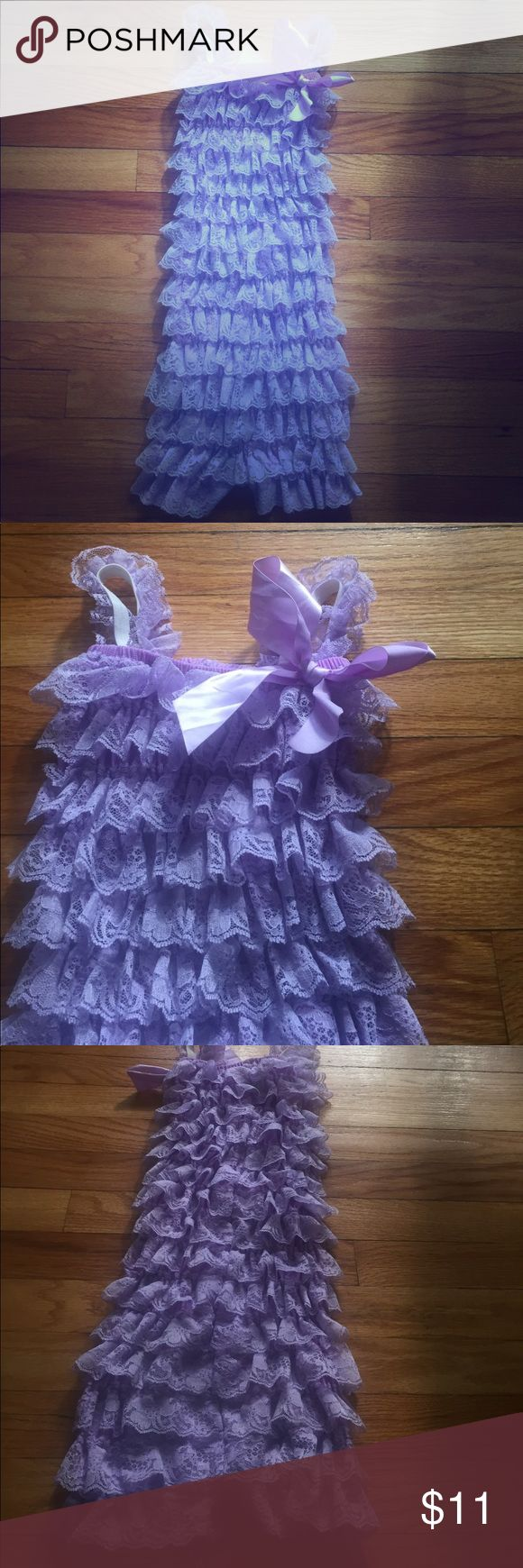 Adorable purple lace romper for girls Worn once. This romper is size xxl and will fit child age 5-7.  Stretchy material One Pieces Bodysuits