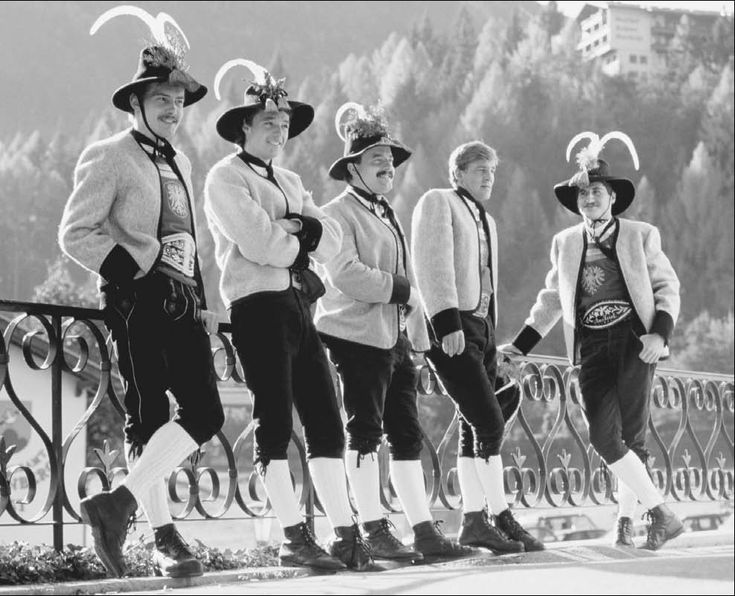 Tyrolean men in native costume. While Austria has eight separate costume districts, Tyrolean clothing is often considered representative of its traditional dress, known as tracht.