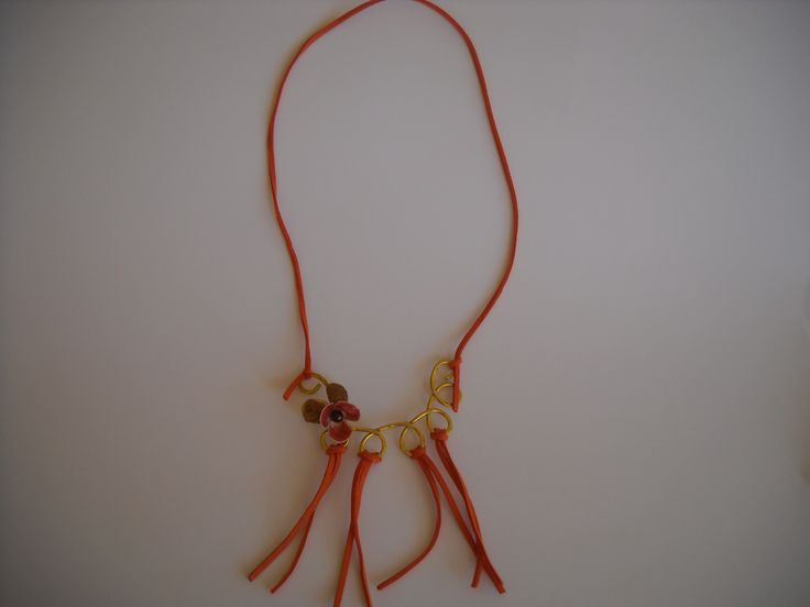 Handmade necklace with aluminium wire, leather, and silk cocoons.