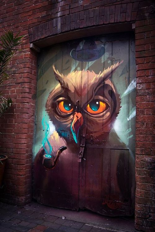 Owl graffiti mural by Fat Head.