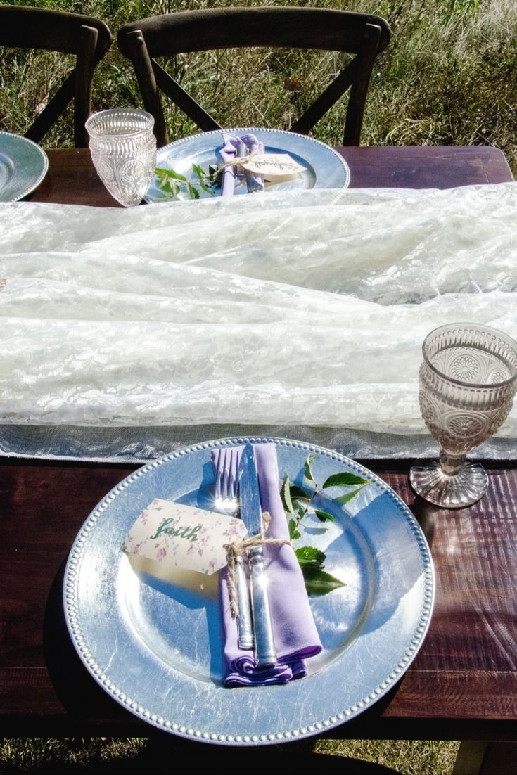 Silver and pretty pastels create a exquisite spring table setting for any outdoor event.
