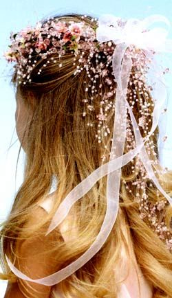 bridal hair flowers and ribbons | This flower girls hair is angelic with a wreath of flowers, ribbons ...