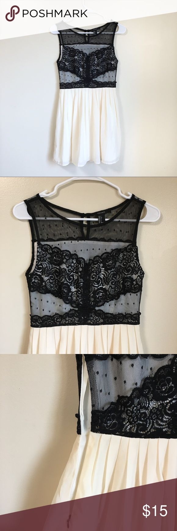 Forever 21 Pleated Lace Dress Semi formal dress with pleated skirt and lace top. Only worn twice with no flaws. Had a zipper on the side. Lace has a cream lining. Only sheer where the top polka dots are. Forever 21 Dresses Mini