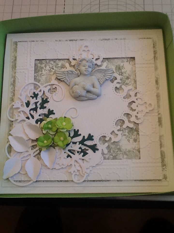 This is a hinged card made using Spellbinders Grand Squares