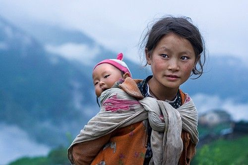 beautiful young Nepali woman with baby. I would love to travel to Nepal someday!