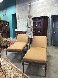 LOT INCLUDES A PAIR OF 79 INCH LONG IRON CHAISE LOUNGE CHAIRS WITH ADJUSTABLE BACKS AND AN OUTDOOR UMBRELLA WITH WOOD ARMS, LINEN FABRIC, CAST IRON BASE AND COVER. COMPLIMENTS THE PATIO PIECES IN LOT 10096, 10179 AND 10140.