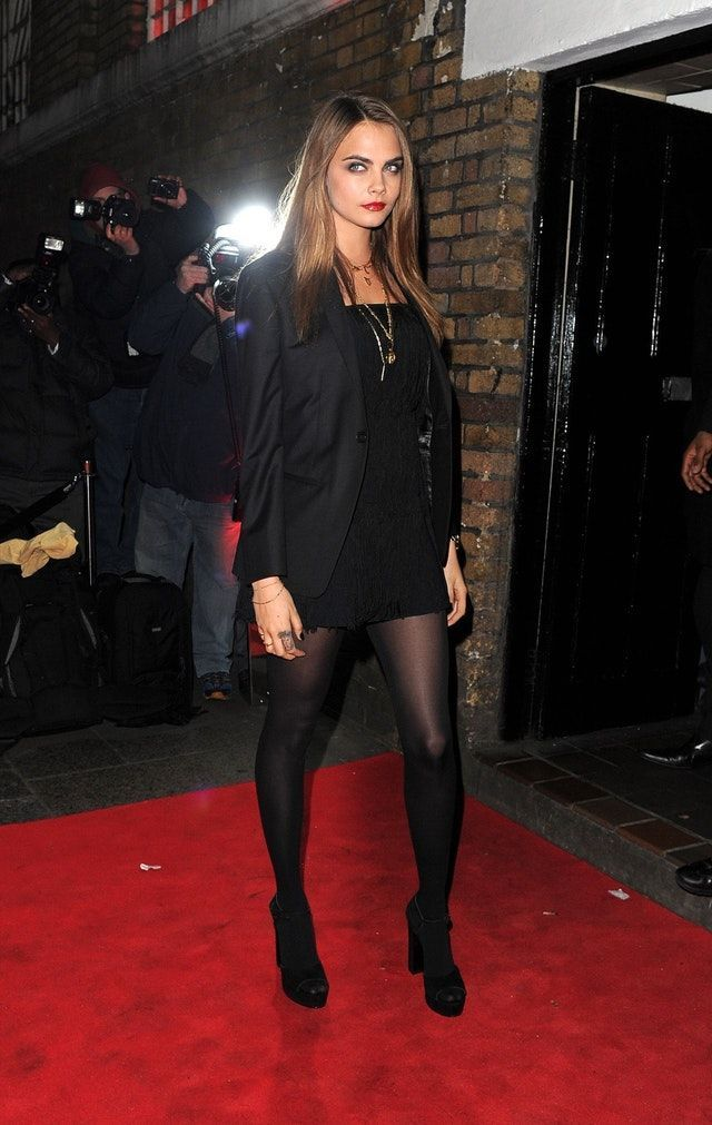 Cara Delevingne sexy in black dress with sheer black pantyhose and heels #blackhighheelswithtights