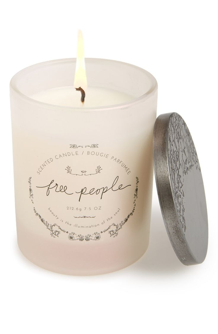 This pink Free People soy candle will add cozy ambiance to any space with a warm glow and subtle aroma of eucalyptus and Siberian pine.