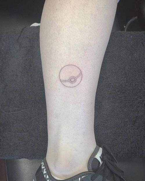 Fine line style pokéball tattoo on the left wrist. Tattoo...