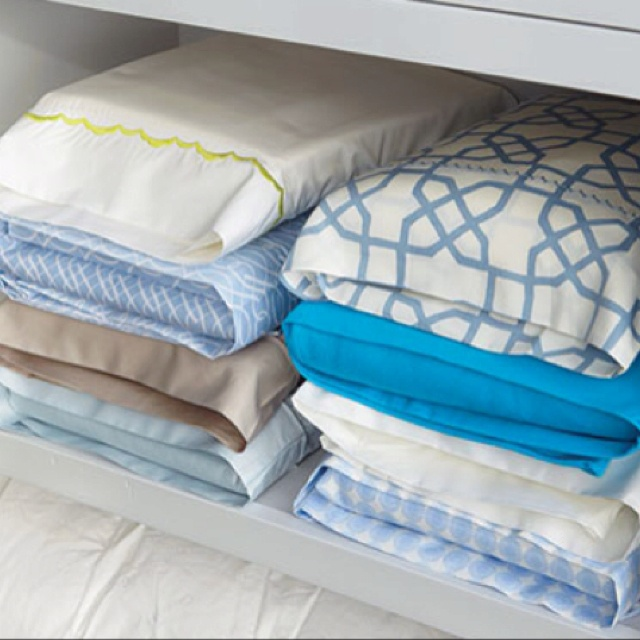 Tidy up your linen closet by storing sheet sets in one of the pillow cases!