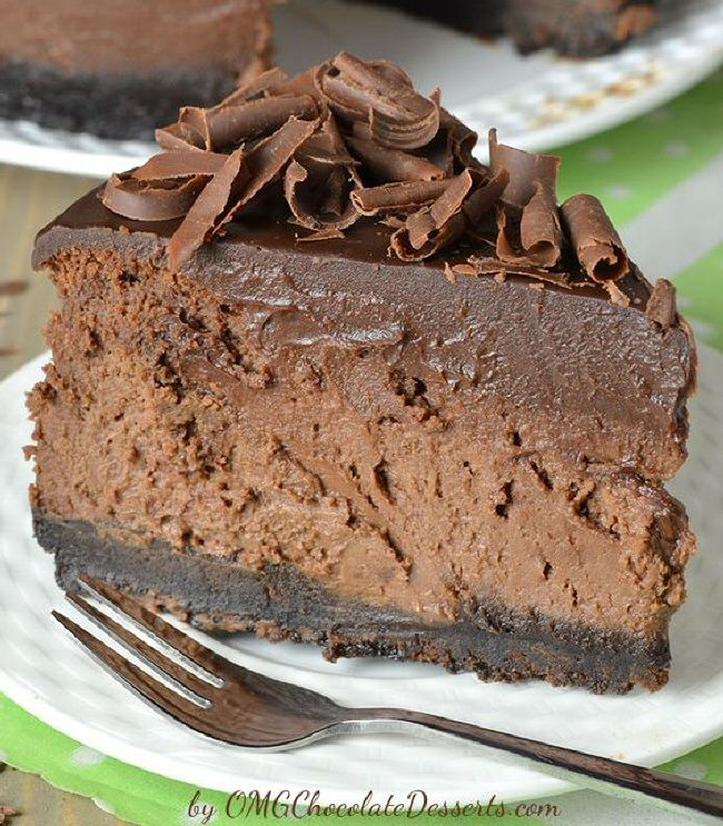 Triple Chocolate Cheesecake with Oreo Crust. The ultimate chocolate lover's dream. The crust is very simple from crushed Oreos & butter baked for 10 minutes. Over it is a thick layer of smeared chocolate cheesecake made of a combination of cream cheese, melted chocolate & cocao & over all that, you pour the unavoidable chocolate ganache. And to make the texture of my cheesecake more interesting, I put a lot of chocolate curls over the top!