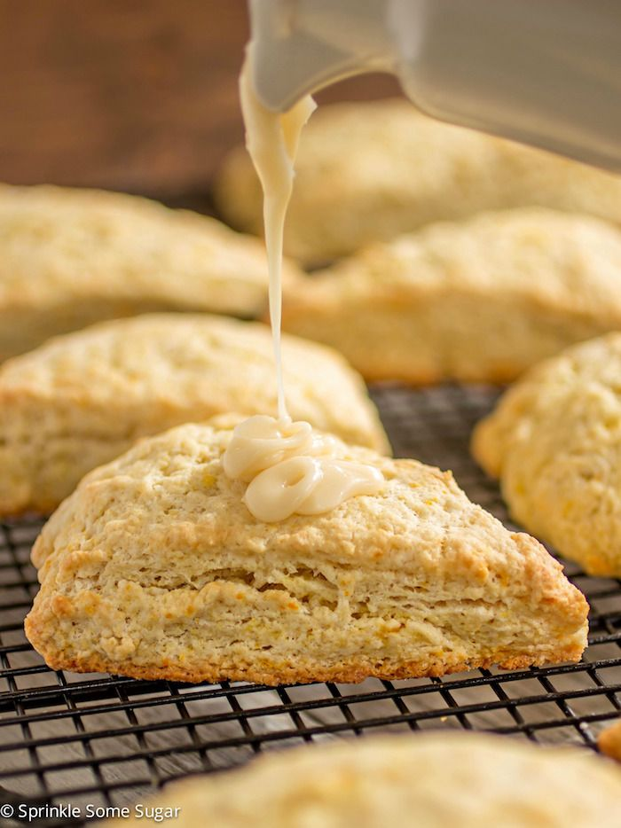 These perfectly tender fresh orange scones have such a bright citrus flavor and are topped off with a sweet + tangy orange glaze.