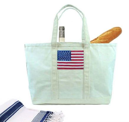 Stars and stripes are forever with this roomy American flag canvas tote bag.