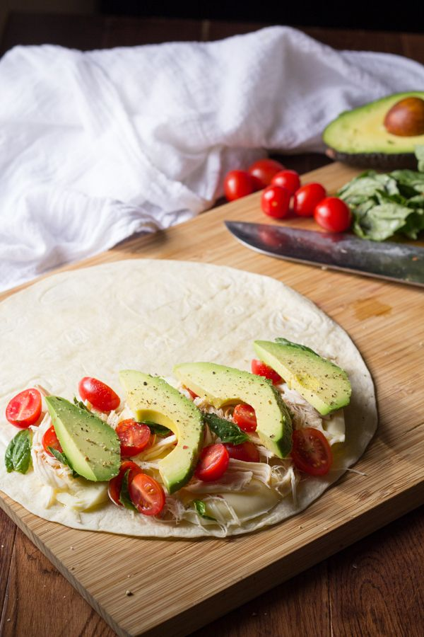 A fast and simple lunch or dinner! Rotisserie chicken, cherry tomatoes, mozzarella cheese and basil leaves are topped with avocado slices and fried up in quesadillas! Ready in under 30 minutes! @Denise | Sweet Peas & Saffron