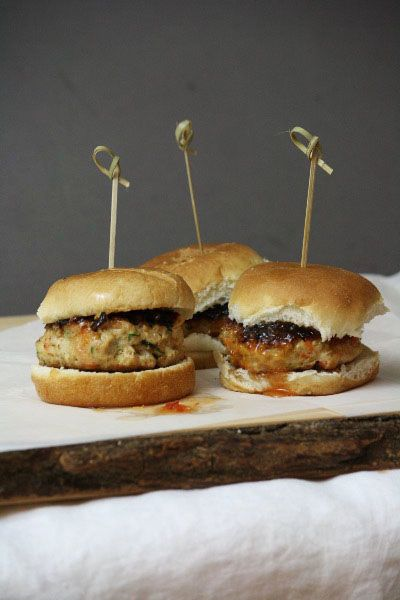 Easy Chicken sliders recipe. Thai flavored, the patties stay moist with shredded carrots and zucchini. All you need is sweet chili sauce for a condiment. Delicious healthy chicken burger recipe. via @lannisam