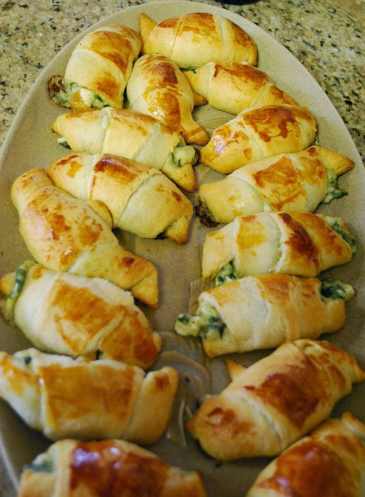 Windy City Crescent Rolls - Served warm and gooey and stuffed with feta and spinach,, These are simple to make and always a great addition to a meal.. it's hard to eat just one :)