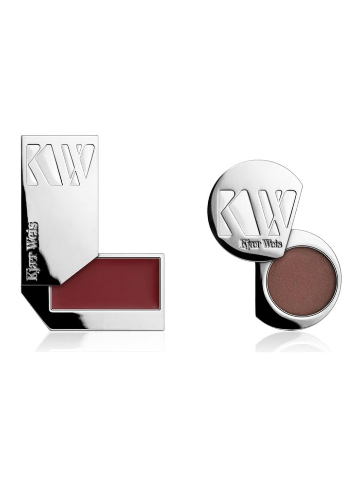 Kjaer Weis Essential Make Up Duo 2: Polished, Classic-Look Duo. This color pairing gives classic definition and is great for businesswomen, or for achieving a polished look. Creates depth around the eye and a little bit of plum color on the lips. Essential Duo 2 is ideal for light to dark skin tones and contains the following: Wisdom Eye Shadow: The taupe of all taupe eye shadows- incredibly enhancing for the eyes, simply a great color. Sensuous Plum Lip Tint: Classic plum lip tint that…
