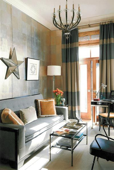 Striped curtains by Frank Roop. Love how the stripes are on the top and bottom, instead of all the way down the panel. Amazing metallic silver leafed walls. Soothing grey themed living room with subtle pops of antique gold. From Apartment Therapy.